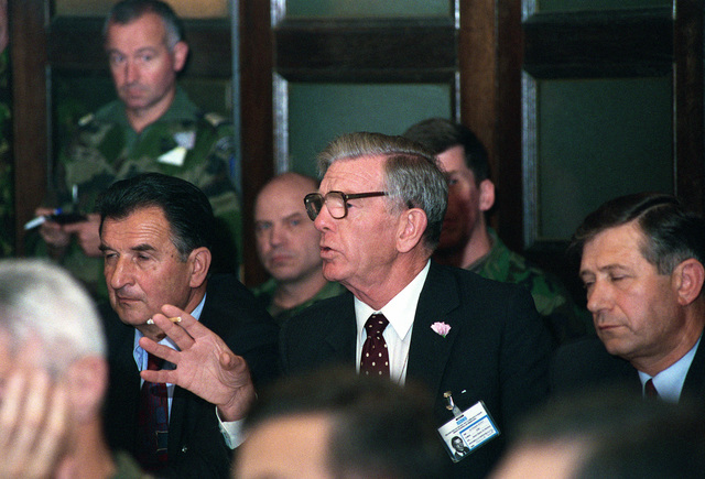 Sir Kenneth Scott (center), SENIOR Deputy for Elections, Organization for the Security and Co-0peration in Europe, makes a statement during a Joint Operations Election Center meeting on election day in Bosnia and Herzegovina. The organizations that comprise the Joint Operations Election Center (JOEC) at the Allied Rapid Reaction Corps Sarajevo, Bosnia and Herzegovina are key leaders or representatives of the Republic of Bosnia and Herzegovina (Bosnian), Federation of Bosnia and Herzegovina (Croatian), Republic of Srpska (Serbian), International Police Task Force, Peace Implementation Forces, Allied Rapid Reaction Corps (ARRC), Organization for the Security and Co-0peration in Europe ...