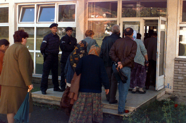 Under police protection, Muslim voters move into segregated polling stations near the town of Rogatica, Republic of Srpska, to cast their ballots on the morning of the Bosnia-Herzegovina national elections