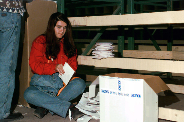 Sanela Merdzanic of Sarajevo helps separate and count ballots from Bosnia's first free election. Implementation Force troops provided security, ensuring the Bosnia and Herzegovina election ballots made it to their proper destination during Operation JOINT ENDEAVOR
