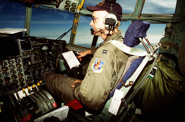 Captain Danial Wagers, co-pilot with the 41st Airlift Squadron, Pope Air Force Base, North Carolina checks flight controls during his flight to Tuzla Air Base. The 41st Airlift Squadron fly C-130 aircraft and are deployed to Ramstein Air Base, Germany
