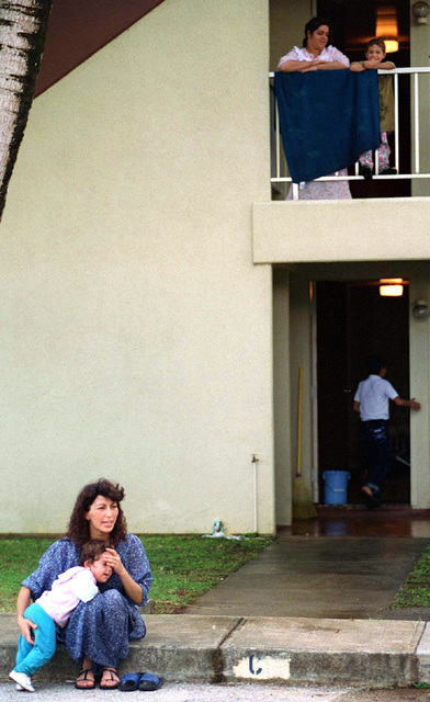 Kurdish evacuees relax outside a family housing complex used as their temporary lodging at Andersen Air Force Base, Guam, during Operation PACIFIC HAVEN. The operation, a joint humanitarian effort conducted by the US military, entails the evacuation of approximately 2,400 Kurds from northern Iraq to avoid retaliation from Iraq for working with the US government and international humanitarian agencies. The Kurds will be housed at Andersen AFB, while they go through the immigration process for residence in the United States