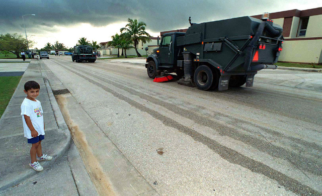 Street cleaners roll down the road of the family housing complex used as temporary lodging for Kurish evacuees at Andersen Air Force Base, Guam, during Operation PACIFIC HAVEN. The operation, a joint humanitarian effort conducted by the US military, entails the evacuation of approximately 2,400 Kurds from northern Iraq to avoid retaliation from Iraq for working with the US government and international humanitarian agencies. The Kurds will be housed at Andersen AFB, while they go through the immigration process for residence in the United States