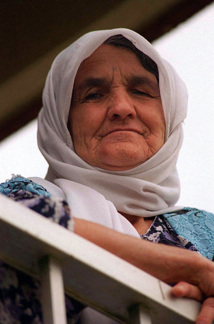 A Kurdish woman relaxes outside a family housing complex used as her temporary lodging at Andersen Air Force Base, Guam, during Operation PACIFIC HAVEN. The operation, a joint humanitarian effort conducted by the US military, entails the evacuation of over 2,400 Kurds from northern Iraq to avoid retaliation from Iraq for working with the US government and international humanitarian agencies. The Kurds will be housed at Andersen AFB, while they go through the immigration process for residence in the United States