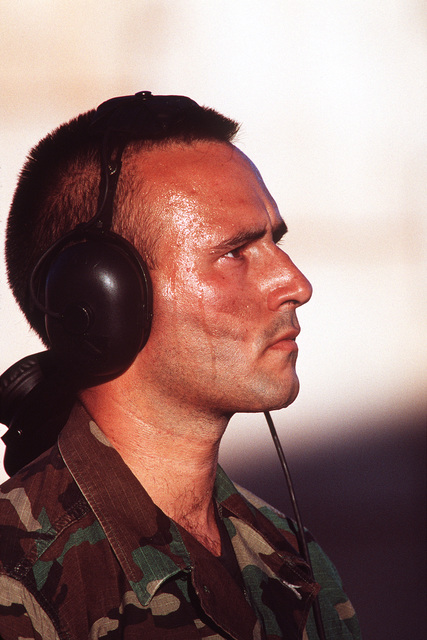 An informal portrait of STAFF Sergeant Paul Irwin, an F-15 crew chief from the 18th Fighter Wing, Kadena Air Base, Japan, shows the effects of the Australian heat as he launches his aircraft. He is participating in Australia's largest air defense exercise, PITCH BLACK '96, held at RAAF bases at Darwin, and Tindal in the Northern Territory and RAAFB Curtain in Western Australia. U.S. forces including Air Force F-16 and F-15 fighters, B-52 bombers, KC-10 tankers, C-141 transports and E-3 Airborne Warning and Control System aircraft. Marine and Army troops teamed up with troops from Australia and Singapore during 15 July to 2 August 1996.Published in AIRMAN Magazine November 1996.Exact Date ...