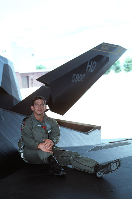 LT. COL. Joe Salata, 49th Fighter Wing CHIEF of Weapons and Training, sits on the wing of his F-117 A Nighthawk that he flew in Desert Storm. LT. COL. Salata flew in the first wave of F-117As that bombed Baghdad. Published in AIRMAN Magazine October 1996