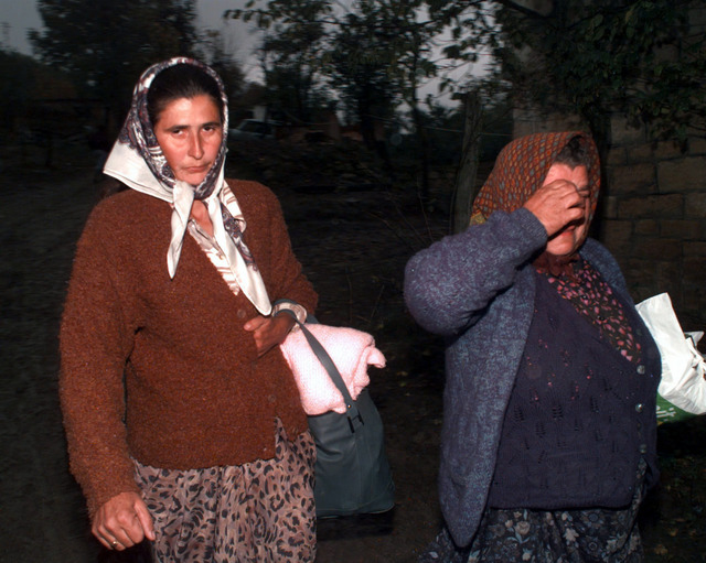 Muslim women carrying bags of possessions and shed tears as they leave the town of Jusici, Bosnia Herzegovina. Residents of the town were asked to leave for a 72- hour period, following a breakdown in the Dayton Peace Accord