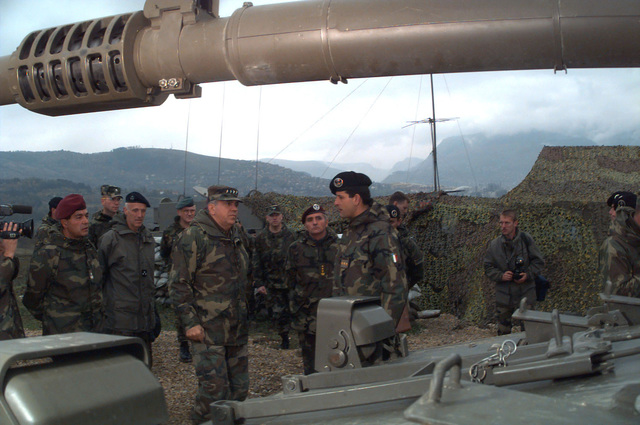 GEN George A. Joulwan (USA), Supreme Allied Commander Europe (SACEUR), talks with an Italian Army tank battery Captain of the 11th field Artillery, 3rd Lione Field Artillery Battery, about the Consortium IVECO - OTO Melara Centauro B1 (8x8) Tank Destroyer, in the immediate foreground, and to personally thank all the Italian Army soldiers present for their dedication and hard working during Operation Joint Endeavor. Operation Joint Endeavor is a peacekeeping effort by a multinational Implementation Force (IFOR), comprised of NATO and non-NATO military forces, deployed to Bosnia in support of the Dayton Peace Accords