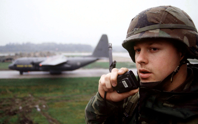 US AIr Force AIRMAN First Class Ricky Robbinette calls in flightline activity to the security police command section at Tuzla Air Base, Bosnia and Herzegovina. A1C Robbinette is a Security Police SPECIALIST at Mildenhall Royal Air Force, England, assigned to the 4100th Group Provisional at Tuzla Air Base, Bosnia and Herzegovina, in support of Operation JOINT ENDEAVOR