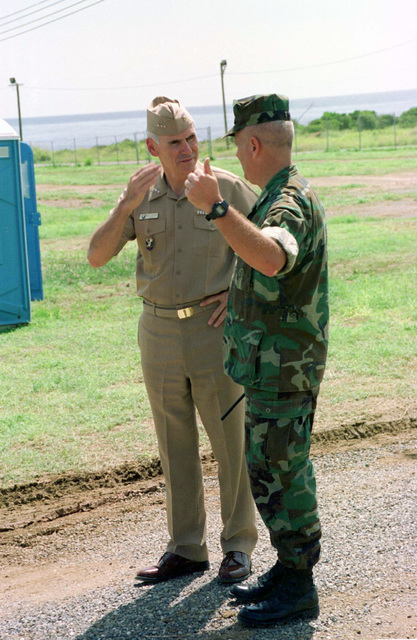 U.S. Navy Vice Admiral Kallon speaks with 3rd Battalion, 8th Marines Commanding Officer Lieutenant Colonel Lefebvre, while touring the migrants facilities on Camp Bravo during Operation MARATHON. Operation MARATHON was a United States Atlantic Command operation , which deployed the Air Contingency Force of II Marine Expeditionary Force, in order to process over 100 Chinese migrants, in Guantanamo Bay, Cuba. Official U.S. Marine Corps photo by Private 1ST Class E.J. Young, 2nd Marine Division Combat Camera Unit