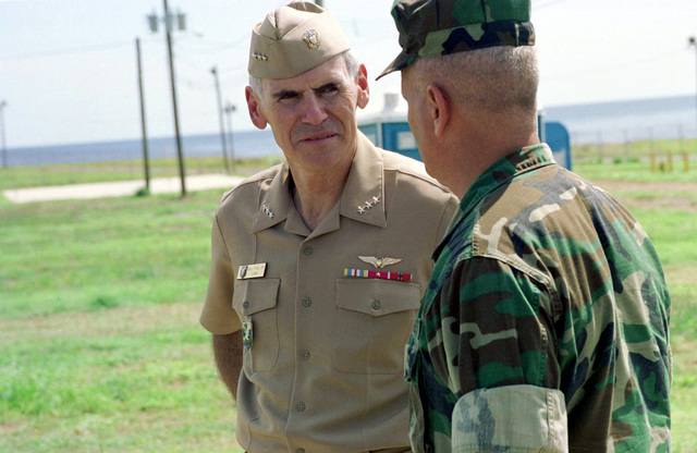US Navy Vice Admiral William J. Fallon speaks with LT. COL. Lefebvre, Commanding Officer, 3d Battalion, 8th Marines, while touring the migrants facilities on Camp Bravo during the operation. This United States Atlantic Command operation deployed the Air Contingency Force of II Marine Expeditionary Force (MEF), to process over 100 Chinese migrants