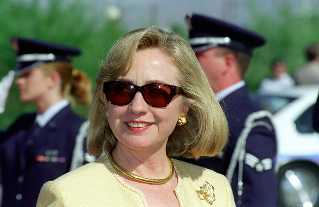 A Close-up view of Hillary Rodham Clinton, wife of President Clinton, receiving a departing salute from the Honor Guard