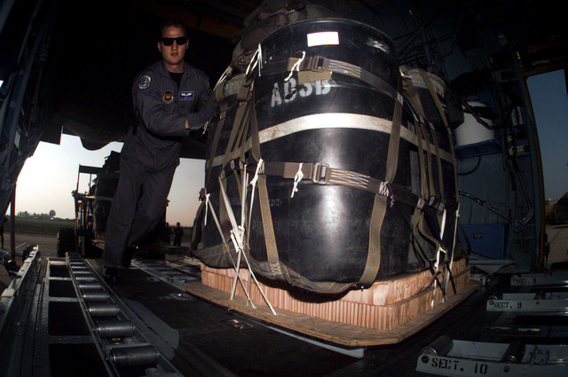A containerized Delivery System (CDS) is loaded onto a C-130 Hercules aircraft, assigned to the 86th Airlift Wing, Ramstein Air Base, Germany, at Otopeni Air Base, in Romania. The CDS will be dropped over a target drop zone during the Partner for Peace Exercise COOPERATIVE KEY '96. The exercise involves Air Forces training in operational and logistics interoperability procedures based on a humanitarian scenario. Participating NATO Air Forces From Greece, Italy, Turkey, and the United States are joined by Partner nations from the Czech Republic, Moldova , Slovazkia and Romania as the host nation