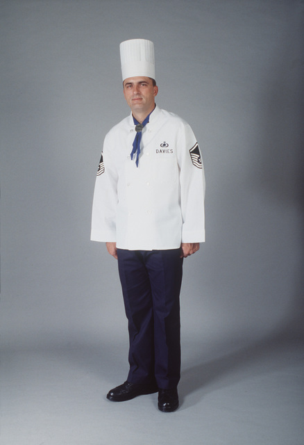 SENIOR AIRMAN Owen Davies models the proposed Formal Service uniform with Navy points, Navy scarf, white buttons and tall hat