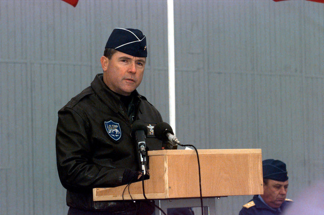 US Air Force Brigadier General Thomas C. Waskow, CHIEF of staff, Head Quarters Allied Forces Southern Europe, takes a few moments to address the participents of the Partnership for Peace Exercise COOPERATIVE KEY '96 during the opening ceremony, at Otopeni Air Base, in Romania. Cooperative Key '96 involves Air Forces training in operational and logistics interoperability procedures based on a humanitarian scenario. Participating Nato Air Forces From Greece, Italy, Turkey, and the United States are joined by Partner nations from the Czech Republic, Moldova, Slovazkia and Romania as the host nation