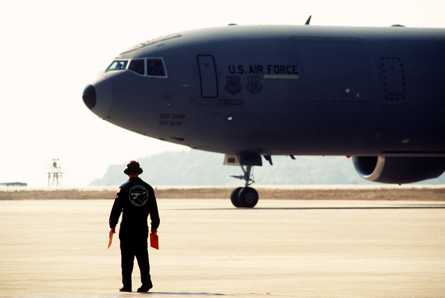 A close-up view of the front half of a KC-10 tanker. It is bringing members of the 90th Fighter Squadron