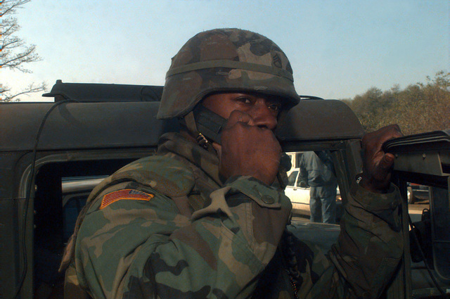 SSGT Dwayne West (US Army), 346th PSYOP Co. (ABN), uses a radio to contact the other members of this unit while on patrol in the Arizona Market Area. The Arizona Market Area is located along Route Arizona, which is in the 1ST Brigade's sector in Bosnia-Herzegovina. The 346th PSYOP Co. (ABN) is in Bosnia participating in Operation Joint Endeavor, which is a peacekeeping effort by a multinational Implementation Force (IFOR), comprised of NATO and non-NATO military forces, deployed to Bosnia in support of the Dayton Peace Accords