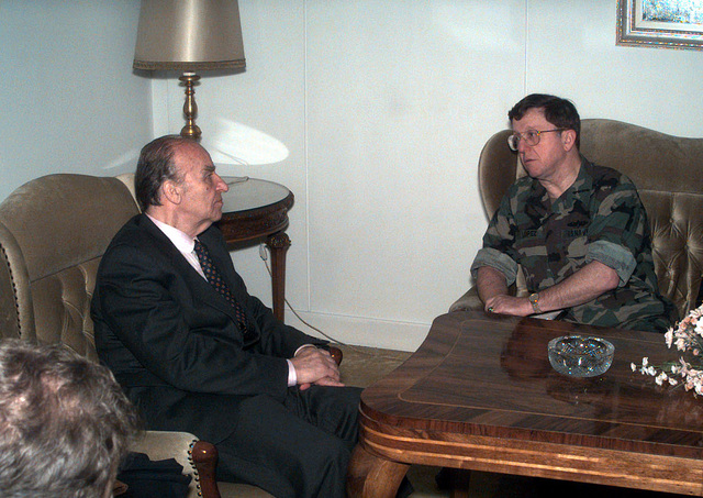 Mr. Alija Izetbegovic (left), President of the Republic of Bosnia Herzegovina and US Navy Admiral T. Joseph Lopez (right), Commander of the Peace Implementation Forces (COMIFOR), meet at the Presidency regarding concerns over destruction of abandoned buildings in and near the Zone of Separation (ZOS) throughout Bosnia and Herzegovina during Operation JOINT ENDEAVOR