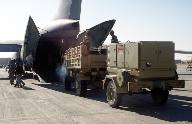Egyptian soldiers load a truck and trailer onto a C-141B Starlifter aircraft during an engine running, on and off loading exercise. The troops are participating in a combined training exercise between Egyptian and United States Forces in joint planning and operations. The exercise is also organized to continue building military-to-military relationships which support regional security