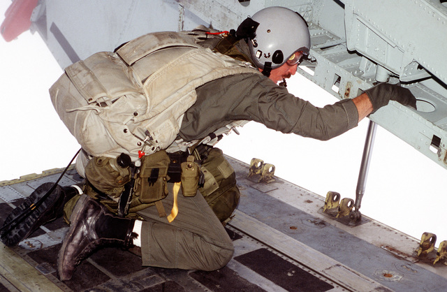 A Combat Controller from the 22nd Special Tactics Squadron, Little Rock Air Force Base, Arkansas looks for the drop zone from the ramp of a C-141B Starlifter aircraft. The exercise is combined training between Egyptian and United States Forces in joint planning and operations. It also was organized to continue building military-to-military relationships which support regional security