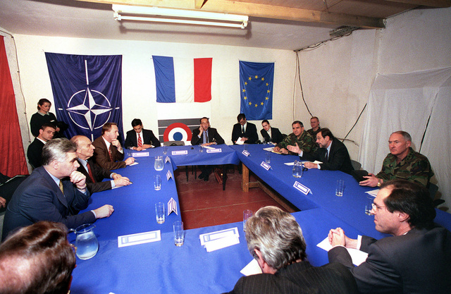 During Operation JOINT ENDEAVOR Presidents Momcilo Krajisnik, Alija Izetbegovic, Kresimir Zubak (left to right, left side of table), of Bosnia and Herzegovina, meet with the Secretary General of NATO, the Honorable Javier Solana, USA Army General George A. Joulwan, Supreme Allied Commander Europe, and US Army General William W. Crouch, commander-in-chief of NATO-led Peace Implementation Forces (IFOR), following the transfer of authority of the Allied Land Forces Central Europe ceremony held at the Sarajevo Airport, Bosnia and Herzegovina