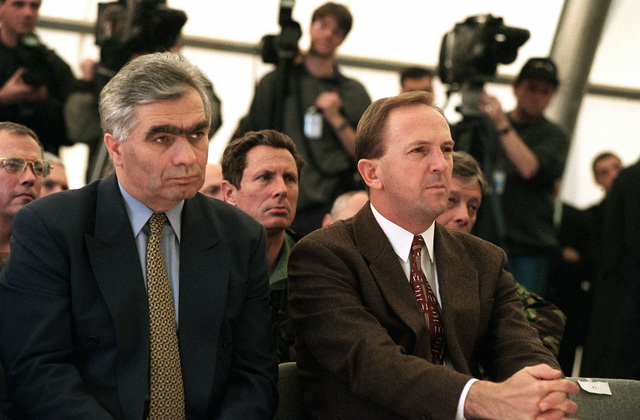 During Operation JOINT ENDEAVOR Presidents Momcilo Krajisnik, and Kresimir Zubak (left to right), of Bosnia and Herzegovina attend the transfer of authority ceremony to Allied Land Forces Central Europe. The ceremony was held at the Sarajevo Airport, Bosnia and Herzegovina