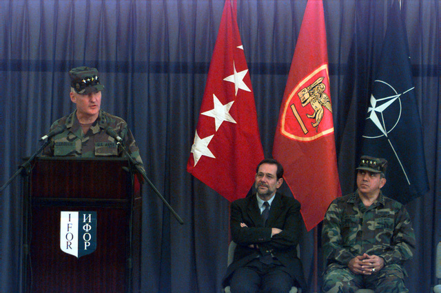 The Honorable Javier Solano, NATO Secretary General, and GEN George A. Joulwan (USA), Supreme Allied Commander Europe (SACEUR), (seated left to right) look on as William W. Crouch (USA), Commander Allied Land Forces Central Europe, speaks from the lectern during ceremony transferring IFOR command authority from Allied forces Southern Europe to Allied Land Forces Central Europe held at the International Airport in Sarajevo, Bosnia-Herzegovina, during Operation Joint Endeavor. Operation Joint Endeavor is a peacekeeping effort by a multinational Implementation Force (IFOR), comprised of NATO and non-NATO military forces, deployed to Bosnia in support of the Dayton Peace Accords