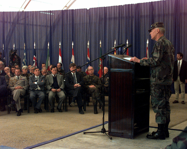 US Army General William W. Crouch, Commander in CHIEF of Allied Land Forces Central Europe, speaks prior to the transfer of authority of Allied Land Forces Central Europe at the Sarajevo International Airport, Sarajevo, Bosnia and Herzegovina during Operation JOINT ENDEAVOR