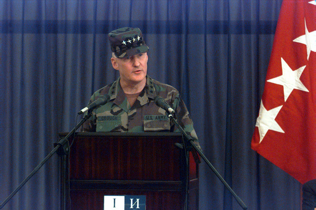 US Army General William W. Crouch, Commander in CHIEF of Allied Land Forces Central Europe, speaks prior to the transfer of authority of Allied Land Forces Central Europe at the Sarajevo International Airport, Sarajevo, Bosnia and Herzegovina, during Operation JOINT ENDEAVOR. GEN William W. Crouch will assume command of the Implementation Force from US Navy Admiral T. Joseph Lopez (not shown), Commander in CHIEF Allied Forces Southern Europe