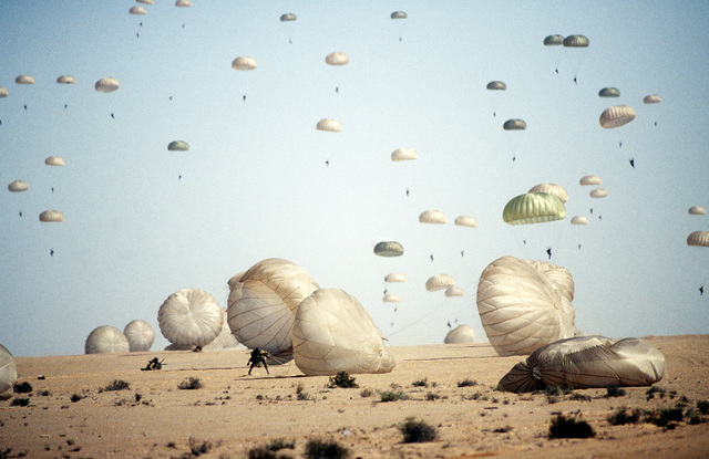 One-hundred Egyptian paratroopers jump out of a United States C-141B Starlifter. These Egyptians are participating in combined training between Egyptian and United States Forces in joint planning and operations. The exercise is also organized to continue building military-to-military relationships which support regional security