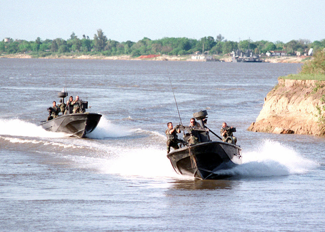 Two Patrol Boat Light (PBL)S from Special Boat Unit (SBU-26) Panama, demonstrate amphibious insertion support techniques during Phase 6 of OPERATION UNITAS 37-96 conducted in Paraguay. SBU-26 and Marines from II Marine Expeditionary Force (MEF) Camp Lejeune, North Carolina, conducted training exercises with marine and naval forces from Paraguay