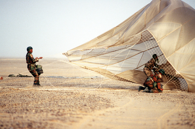 Egyptian troops gather a parachute after a mass halo jump. The main objective of the mass halo jumps was to improve the ability to rapidly reinforce deployed Egyptian Forces