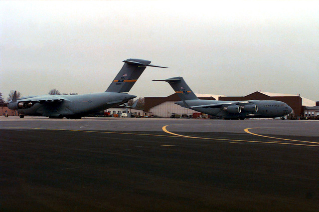 C-17 Globemaster III aircraft from Charleston Air Force Base, South Carolina parked on the flight line ramp. The aircraft and crews are on a temporary deployment supporting a pending air movement of troops and equipment for the humanitarian mission in Central Africa