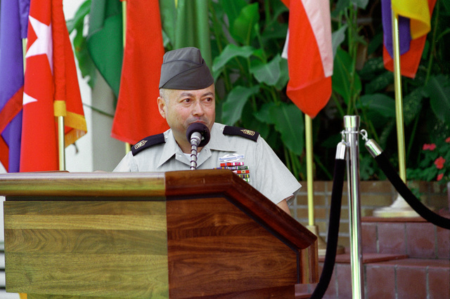 Command Sergeant Major Carlos Legoas, at the lectern gives his acceptance speech on assuming the Command Sergeant Major position of United States Southern Command, in Panama