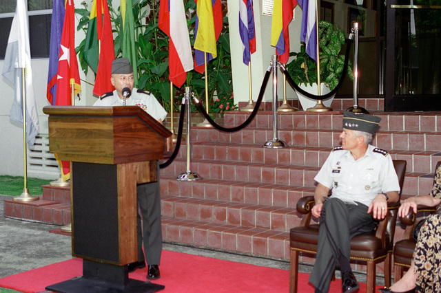 Command Sergeant Major Carlos Legoas, at the lectern gives his acceptance speech on assuming the Command Sergeant Major position of United States Southern Command, (SOUTHCOM), in Panama looking over at General Wesley K. Clark, Commander of SOUTHCOM