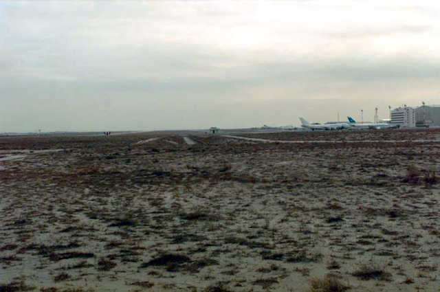 View looking south near Ceilometer is the ditch that runs into the culvert on the northeast perimeter road. This area could pose a potential security threat for United States military personnel working at the airport. To the right is the Eastern Apron with a contract Boeing 747 on the ramp.SCREEN RESOLUTION ONLY