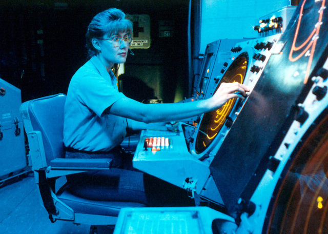 US Navy Air Traffic Controller 2ND Class Bradley, monitors aircraft in the Carrier Air Traffic Control Center (CATCC), onboard the US Navy aircraft carrier USS KITTY HAWK (CV 63). The Kitty Hawk is on deployment to the Western Pacific and Arabian Sea