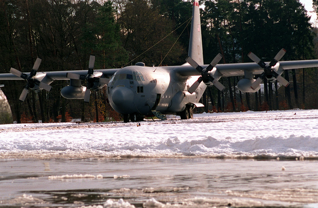 A C-130 Hercules from Dyess Air Force Base sits on the runway in the snow and ice. Dyess maintainers were not accustomed to the magnitude of the snow and ice