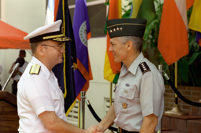 After assuming command of DCINC, Rear Admiral Walter S. Doran is welcomed aboard by CINC, U.S. Southern Command, General Wesley K. Clark