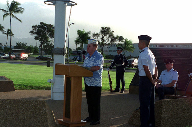 US Air Force SENIOR Airmen (SRA) Jose Olivieri of the 15th Air Base Wing Honor Guard, Hickam AFB, Hawaii, stand guard as Mr. Robert May a survivor of the attack on Pearl Harbor, describes how he survived the Japanese bombers by hiding in a manhole. US Air Force Colonel (COL) Bruce Brown (seated), Commander, 15th Air Base Wing, and USAF Major (MAJ) Joseph Davis (standing) are also in attendance
