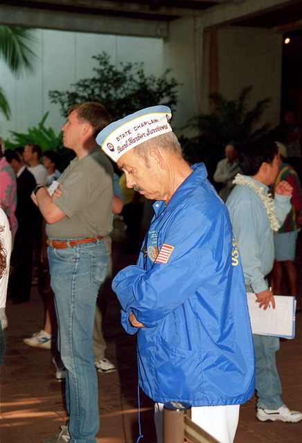 US Navy (retired) PETTY Officer 3rd Class (PO3) Glen C. Hoytt, observes a moment of silence during the Pearl Harbor Commemoration at the USS ARIZONA Memorial Visitor Center, Pearl Harbor, HI. Mr. Hoytt one of the survivors of the Pearl Harbor attack served on the USS SAINT LOUIS