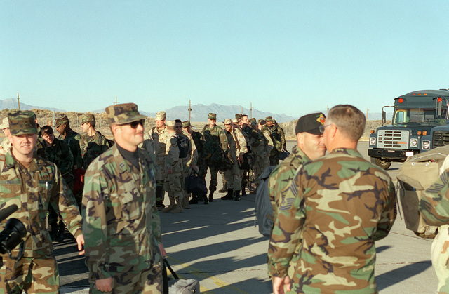 Members of the 8th Fighter Squadron board an aircraft to deploy for DESERT STRIKE replacing members of the 9th Fighter Squadron
