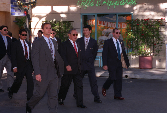 Special agents from DET4, Los Angeles Air Force Base, escort the Chinese Minister of Defense through Universal Studios