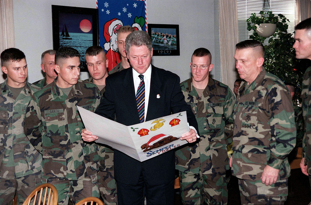 During President William J. Clinton's visit to the 8th Marines' Chowhall, Marines from 8th Marine Regiment, 2d Marine Division, gave the President a home-made Christmas card. Clinton earlier addressed the families of Marines and Sailors, currently stationed at Marine Corps Base Camp Lejeune, North Carolina, as well as in the Jacksonville community, during his speech at the Goettge Field Memorial House
