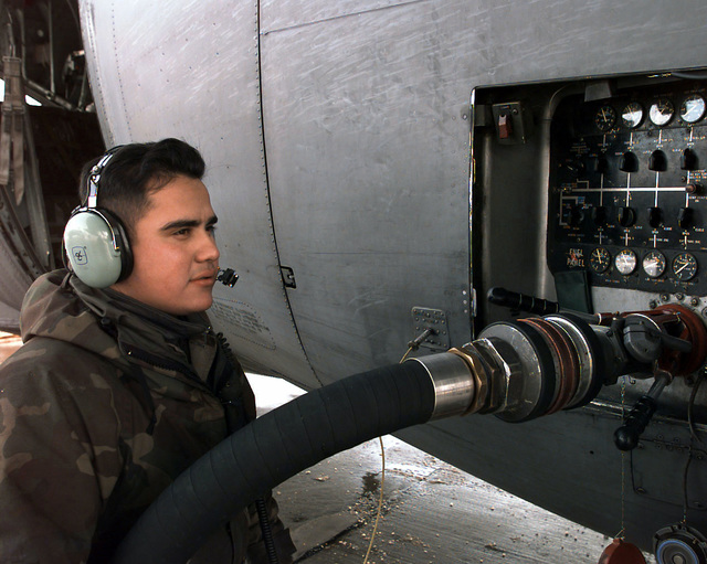 A1C William Holguin (USAF), 7th AMS, monitors the fuel flow while fueling a C-130 at Ramstein AB, Germany. The 7th AMS is supporting units involved in Operation Joint Endeavor supply missions. Operation Joint Endeavor is a peacekeeping effort by a multinational Implementation Force (IFOR), comprised of NATO and non-NATO military forces, deployed to Bosnia in support of the Dayton Peace Accords