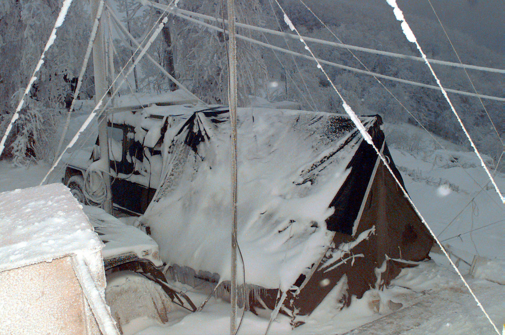 An ice and snow-covered Danish Dvision NODE Center tent and vehicle located on Hilltop 722, Bosnia-Herzegovina. The Danes are working with the 121st Signal Battalion in supporting forces involved in Operation Joint Endeavor. Operation Joint Endeavor is a peacekeeping effort by a multinational Implementation Force (IFOR), comprised of NATO and non-NATO military forces, deployed to Bosnia in support of the Dayton Peace Accords