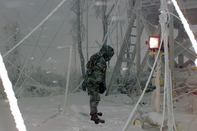 SPECIALIST Gyspsy R. Martinez, from Charlie Company, 121st Signal Battalion, replaces fallen and broken radar poles on Hilltop 722 during Operation JOINT ENDEAVOR. Hilltop 722 is one of the signal sites in Tuzla. On December 20, 1996, the Implementation Force (IFOR) mission came to a conclusion and the 1ST Infantry Division was selected to continue serving in Bosnia as part of the new Stabilization Force (SFOR). This decision brought to close the peace mission of Operation JOINT ENDEAVOR and has been the beginning for the current operation known as Operation JOINT GUARD. JOINT GUARD will continue to monitor the militaries of the former warring factions and provide a climate of stability