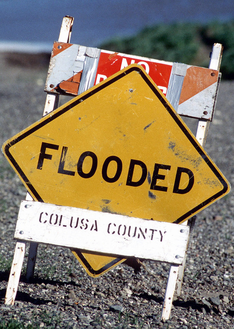 A flooded sign stands near the town of Meridian, California. The town has become a victim to the rising flood waters of the Sacramento River. Fort Bragg, Beale Air Force Base and the Federal Emergency Management Agency (FEMA) provided sand bag working party personnel in an attempt to save the town from the rising flood waters