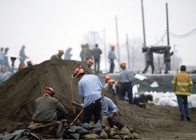 Inmates from the Parlin Fork Prison Facility in Fort Bragg, CA, fill sandbags in the small northern California (CA) town of Meridian, near Beale Air Force Base. The inmates were brought in by the Federal Emergency Management Agency (FEMA) in an attempt to save the town from the rising flood waters of the Sacramento River