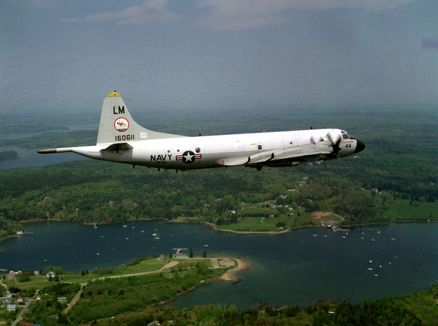 Aerial right side view of a P-3C Orion anti-submarine warfare (ASW) aircraft of Patrol Squadron Forty-Four (VP-44) in flight over New England. The aircraft, bureau #LM-08-160611, is the personal aircraft of the squadron commanding officer, CDR A.M. Harms , as painted on the nose of the aircraft