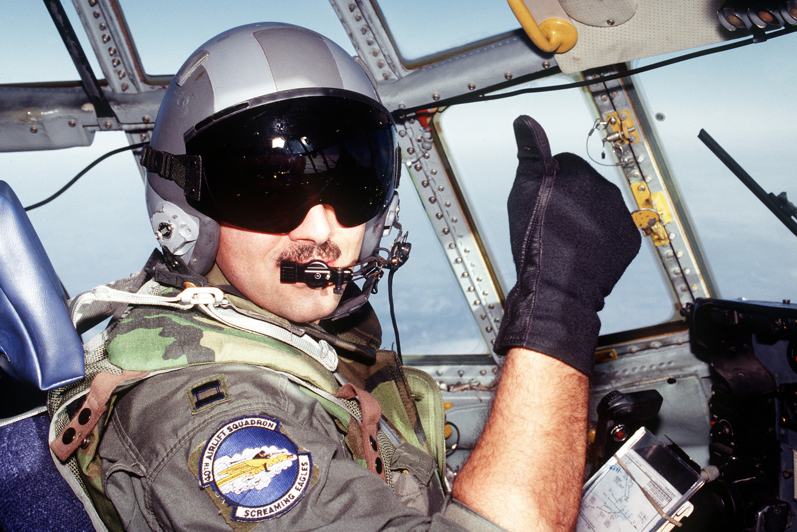 """C-130H Pilot, CAPT. Dan Dahger, assigned to the 40th Airlift Squadron (AS) gives the """"thumbs up"""" as the C-130H crew prepares to enter the war torn area of Tuzla, Bosnia. The 40th AS is assigned to the 7th Wing, Dyess Air Force Base, Texas and is deployed to Ramstein to support Operations Joint Endeavor and Joint Guard from 4 Dec. 1996 to 23 Jan. 1997. Exact Date Shot Unknown"""